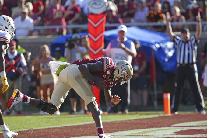 Florida State's James Blackman scores against Louisiana-Monroe in the second quarter of an NCAA college football game Saturday, Sept. 7, 2019, in Tallahassee Fla. (AP Photo/Steve Cannon)