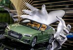 An Audi A5 4.0 TDI Quattro is displayed at the IAA Auto Show in Frankfurt, Germany, Monday, Sept. 9, 2019. The IAA starts with two media days on Tuesday and Wednesday. (AP Photo/Michael Probst)