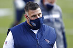 Tennessee Titans head coach Mike Vrabel leaves the field after losing to the Baltimore Ravens in an NFL wild-card playoff football game Sunday, Jan. 10, 2021, in Nashville, Tenn. The Ravens won 20-13. (AP Photo/Wade Payne)