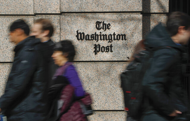 FILE - In this Thursday, Feb. 21, 2019, file photo, people walk by the One Franklin Square Building, home of The Washington Post newspaper, in downtown Washington. Washington Post political reporter Felicia Sonmez, who had been placed on administrative leave after she tweeted a link to a story about a 2003 rape allegation against Kobe Bryant, has been cleared to return to work, the paper said Tuesday, Jan. 28, 2020. (AP Photo/Pablo Martinez Monsivais, File)