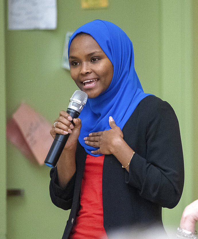 CORRECTS SPELLING OF LAST NAME TO KHALID INSTEAD OF KAHLID - Safiya Khalid speaks at a candidates forum at Geiger Elementary School in Lewiston, Maine.  Lewiston, a city in Maine that is home to thousands of African newcomers, elected Khalid, a Somali American to its city council after she soundly defeated a fellow Democrat on Tuesday.   (Andree Kehn/Sun Journal via AP)