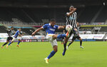 Brighton's Neal Maupay, left, duels for the ball with Newcastle's Andy Carroll during the English Premier League soccer match between Newcastle United and Brighton at St. James' Park in Newcastle, England, Sunday, Sept. 20, 2020. (Lee Smith/Pool via AP)