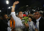 Thai Prime Minister Prayuth Chan-ocha of the Palang Pracharat Party waves to supporters in Bangkok, Thailand, Friday, March 22, 2019. The political movement that has won every Thai election in nearly two decades is facing its biggest test yet: Squaring off against the allies of the military junta that removed it from power and rewrote the electoral rules with the goal of putting an end to those victories. (AP Photo/Sakchai Lalit)