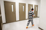 """In this Tuesday, May 1, 2018 photo, inmate Richard Walls walks back to his cell block after an interview at Richmond City Jail in Richmond, Va. A federal appeals court is weighing a challenge to a Virginia law that allows police to arrest """"habitual drunkards"""" and send them to jail for up to a year for possessing alcohol. (AP Photo/Steve Helber)"""
