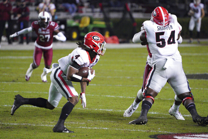 Georgia running back James Cook (4) carries the ball during the first half of the team's NCAA college football game against South Carolina on Saturday, Nov. 28, 2020, in Columbia, S.C. (AP Photo/Sean Rayford)