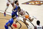 Louisiana Tech guard Kalob Ledoux (5) defends as Western Kentucky guard Taveion Hollingsworth (11) moves to the basket during the second half of an NCAA college basketball game in the quarterfinals of the NIT, Thursday, March 25, 2021, in Frisco, Texas. (AP Photo/Tony Gutierrez)