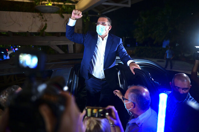 Pedro Pierluisi, gubernatorial candidate with the New Progressive Party (PNP), arrives at Vivo Beach Club to celebrate a slim lead of the pro-statehood party in the Puerto Rican general elections, in Carolina, Puerto Rico, Tuesday, Nov. 3, 2020. Pierluisi briefly served as governor following last year's massive protests that led to the resignation of former Gov. Ricardo Rosselló. (AP Photo/Carlos Giusti)