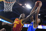 Southern California forward Onyeka Okongwu, left, and UCLA guard Chris Smith reach for a rebound during the first half of an NCAA college basketball game Saturday, Jan. 11, 2020, in Los Angeles. (AP Photo/Mark J. Terrill)