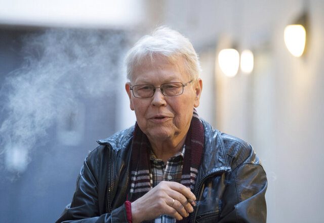 File---Picture taken March 13, 2019 shows irector Harry Kupfer smokes during the break of the photo rehearsal of Handel's opera