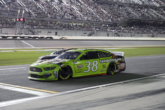 Anthony Alfredo (38) makes his way down pit road after making a pit stop during a NASCAR Cup Series auto race at Daytona International Speedway, Saturday, Aug. 28, 2021, in Daytona Beach, Fla. (AP Photo/Phelan M. Ebenhack)