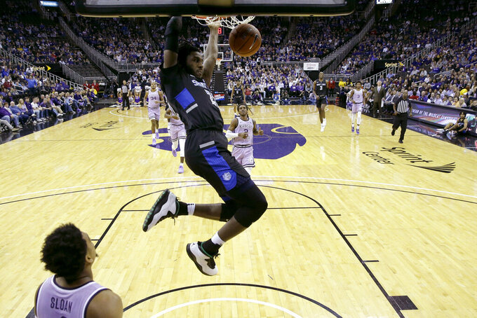 Saint Louis' Terrence Hargrove Jr. (22) dunks during the second half of an NCAA college basketball game against Kansas State, Saturday, Dec. 21, 2019, in Kansas City, Mo. (AP Photo/Charlie Riedel)