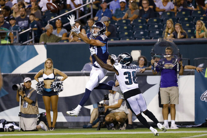 Tennessee Titans' Tanner McEnoy, left, catches a touchdown pass over Philadelphia Eagles' Jeremiah McKinnon during the second half of a preseason NFL football game Thursday, Aug. 8, 2019, in Philadelphia. (AP Photo/Michael Perez)