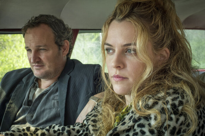 This image released by Netflix shows Jason Clarke, left, and Riley Keough in a scene from