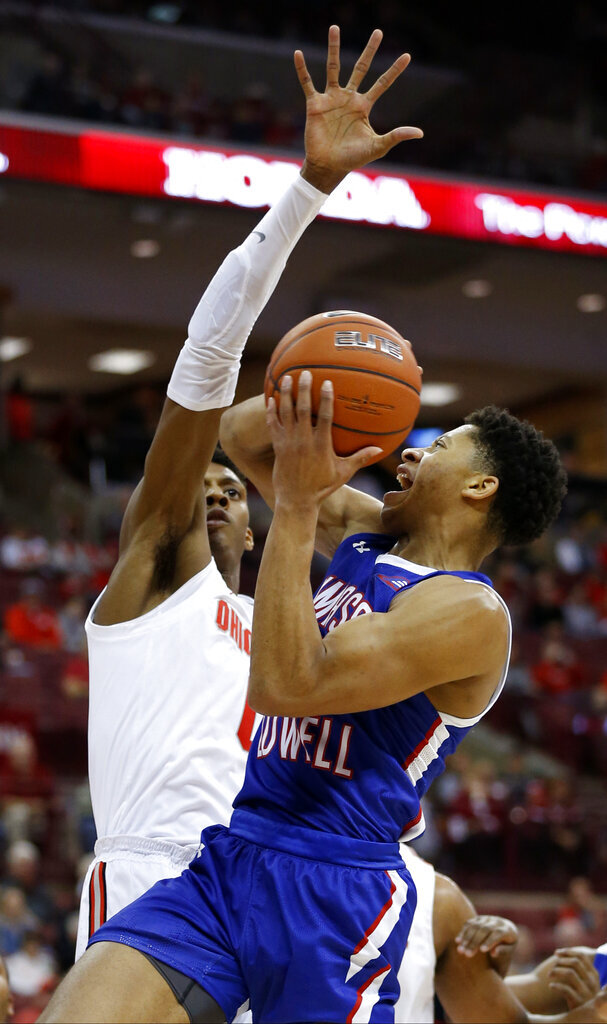 UMass-Lowell's Obadiah Noel, right, tries to shoot over Ohio State's Alonzo Gaffney during the first half of an NCAA college basketball game Sunday, Nov. 10, 2019, in Columbus, Ohio. (AP Photo/Jay LaPrete)