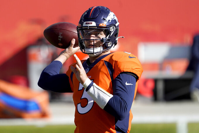 Denver Broncos quarterback Drew Lock (3) warms up prior to an NFL football game against the Los Angeles Chargers, Sunday, Nov. 1, 2020, in Denver. (AP Photo/Jack Dempsey)