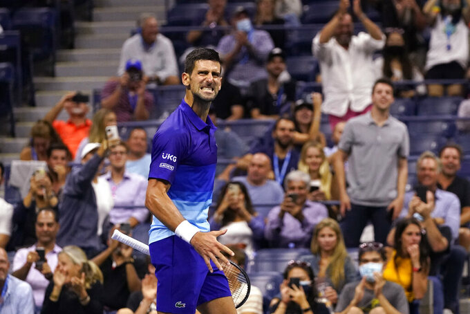 Novak Djokovic, of Serbia, reacts after scoring a point against Matteo Berrettini, of Italy, during the quarterfinals of the U.S. Open tennis tournament early Thursday, Sept. 9, 2021, in New York. (AP Photo/Frank Franklin II)