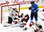 New Jersey Devils goaltender Mackenzie Blackwood (29) makes a save as Matt Tennyson (7) defends and Winnipeg Jets' Andrew Copp (9) looks for the rebound during the first period of an NHL hockey game, Tuesday, Nov. 5, 2019 in Winnipeg, Manitoba. (Fred Greenslade/Canadian Press via AP)