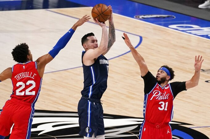 Philadelphia 76ers guard Matisse Thybulle (22) and guard Seth Curry (31) defend against a shot by Dallas Mavericks guard JJ Redick, center, in the first half of an NBA basketball game in Dallas, Monday, April 12, 2021. (AP Photo/Tony Gutierrez)