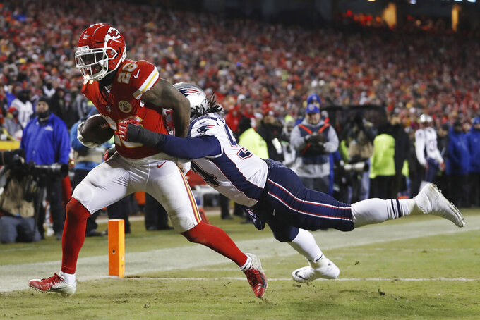 Kansas City Chiefs running back Damien Williams (26) makes a touchdown reception against New England Patriots outside linebacker Dont'a Hightower (54) during the second half of the AFC Championship NFL football game, Sunday, Jan. 20, 2019, in Kansas City, Mo. (AP Photo/Jeff Roberson)
