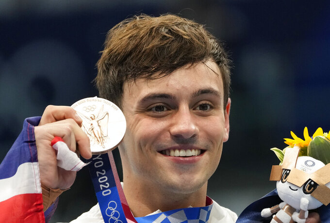 Thomas Daley of Great Britain poses for a photo after winning bronze medal in men's diving 10m platform final at the Tokyo Aquatics Centre at the 2020 Summer Olympics, Saturday, Aug. 7, 2021, in Tokyo, Japan. (AP Photo/Dmitri Lovetsky)