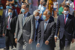 Spain's King Felipe VI, Portugal's President Marcelo Rebelo de Sousa, foreground, Portugal's Prime Minister Antonio Costa and Spain's Prime Minister Pedro Sanchez, background, walk during a ceremony to mark the reopening of the Portugal/Spain border in Elvas, Portugal, Wednesday, July 1, 2020. The border was closed for three and a half months due to the coronavirus pandemic. (AP Photo/Armando Franca)