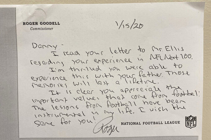 This undated image provided by the NFL, shows a hand written note from NFL Commissioner Roger Goodell to sixth-grader Danny Speski from Chicago. Speski received an autographed football from New York Giants running back Saquon Barkley and a handwritten letter from NFL Commissioner Roger Goodell, after Speski wrote to the league about his experience entering a Super Bowl contest. (NFL via AP)