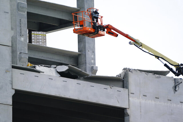 Damage is seen to a parking deck under construction after it partially collapsed, injuring several workers, on Friday, Sept. 11, 2020, in Atlanta. (AP Photo/Elijah Nouvelage)