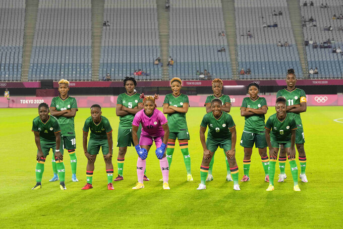 Zambia's players pose for a team photo prior to a women's soccer match against Netherlands at the 2020 Summer Olympics, Wednesday, July 21, 2021, in Rifu, Japan. (AP Photo/Andre Penner)