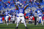 Kentucky defensive tackle Marquan McCall (50) celebrates an interception during the first half of an NCAA college football game against Georgia, Oct. 31, 2020, in Lexington, Ky. (AP Photo/Bryan Woolston)