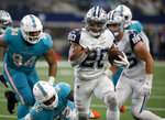 Dallas Cowboys running back Tony Pollard (20) runs the ball as Miami Dolphins middle linebacker Raekwon McMillan (52) and Christian Wilkins (94) give chase in the second half of an NFL football game in Arlington, Texas, Sunday, Sept. 22, 2019. (AP Photo/Ron Jenkins)