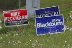 FILE - In this May 1, 2020 file photo, campaign signs for local government candidates are displayed along a roadside in Wexford, Pa. The state's primary election is June 2 and will feature legislative and congressional races, a first run for some new paper-record voting systems and the inaugural use of newly legalized mail-in ballots. Pennsylvanians have embraced the state's new vote-by-mail option that was passed last year. It has been widely adopted as a way to avoid pandemic exposure.(AP Photo/Keith Srakocic, File)