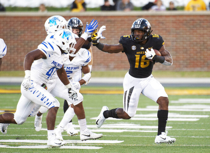 Missouri running back Damarea Crockett, right, runs past Memphis defenders during the second half of an NCAA college football game Saturday, Oct. 20, 2018, in Columbia, Mo. Missouri won 65-33. (AP Photo/L.G. Patterson)
