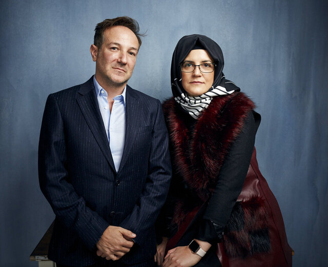 Director Bryan Fogel, left, and Hatice Cengiz pose for a portrait to promote the film