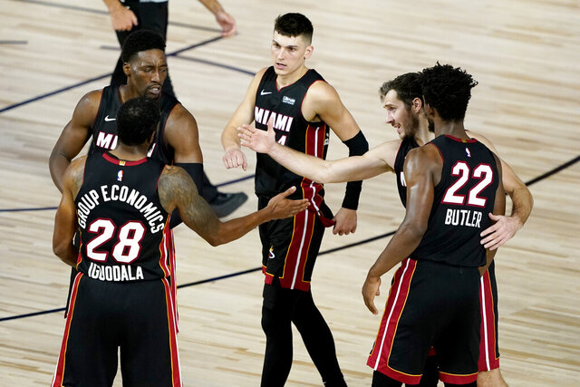 The Miami Heat celebrate their win after an NBA basketball first round playoff game against the Indiana Pacers, Monday, Aug. 3, 2020, in Lake Buena Vista, Fla. The Heat won 109-100. (AP Photo/Ashley Landis, Pool)