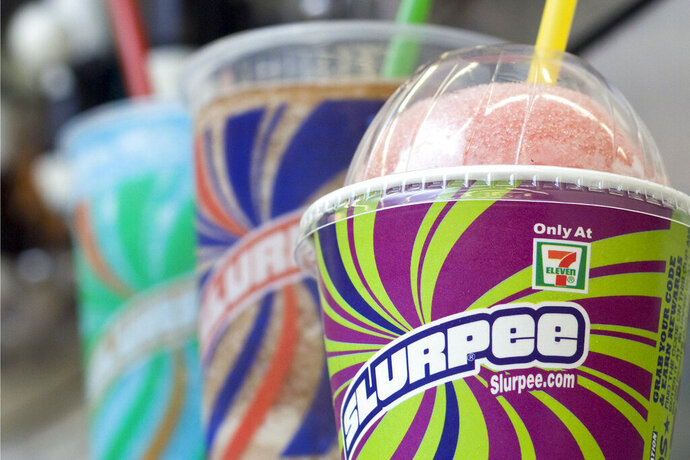 FILE - In this Nov. 10, 2010, file photo, Slurpees are displayed at a 7-Eleven store in Concord, N.H. The coronavirus pandemic has taken away another summertime tradition in the U.S.: There will be no free Slurpees at 7-Elevens on Saturday — July 11 — to hail a date that doubles as an abbreviation of the convenience store chain's name.  (AP Photo/Larry Crow, File)