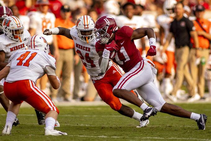 Alabama wide receiver Traeshon Holden (11) runs by Mercer linebacker Danijah Gammage (24) during the second half of an NCAA college football game, Saturday, Sept. 11, 2021, in Tuscaloosa, Ala. (AP Photo/Vasha Hunt)