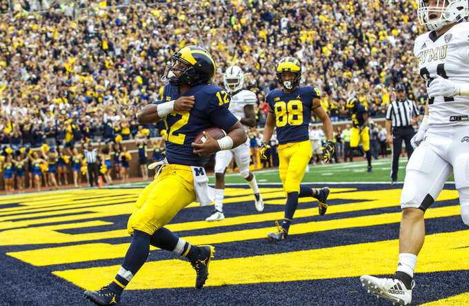 Michigan running back Chris Evans (12) celebrates his touchdown in the first quarter of an NCAA college football game against Western Michigan in Ann Arbor, Mich., Saturday, Sept. 8, 2018. (AP Photo/Tony Ding)