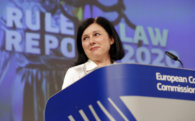 European Commissioner for Values and Transparency Vera Jourova speaks during a media conference on the Rule of Law Report 2020 at EU headquarters in Brussels, Wednesday, Sept. 30, 2020. (Olivier Hoslet, Pool via AP)
