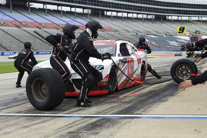 Brandon Jones (19) pits during a NASCAR Xfinity Series auto race at Texas Motor Speedway in Fort Worth, Texas, Saturday, Oct. 24, 2020. (AP Photo/Richard W. Rodriguez)