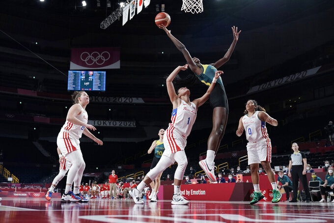 Australia's Ezi Magbegor, second from right, leaps over Puerto Rico's Tayra Melendez (1) to grab a rebound during a women's basketball game at the 2020 Summer Olympics, Monday, Aug. 2, 2021, in Saitama, Japan. (AP Photo/Eric Gay)