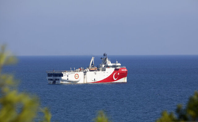 Turkey's research vessel, Oruc Reis anchored off the coast of Antalya on the Mediterranean, Turkey, Sunday, Sept. 13, 2020. Greece's Prime Minister Kyriakos Mitsotakis welcomed the return of a Turkish survey vessel to port Sunday from a disputed area of the eastern Mediterranean that has been at the heart of a summer stand-off between Greece and Turkey over energy rights.(AP Photo/Burhan Ozbilici)
