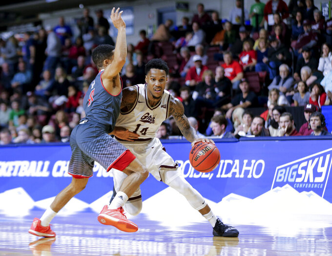 Montana's Ahmaad Rorie (14) tries to move the ball around Eastern Washington's Tyler Kidd during an NCAA college basketball game in the championship of the Big Sky men's tournament in Boise, Idaho, Saturday, March 16, 2019. Montana won 68-62. (AP Photo/Otto Kitsinger)