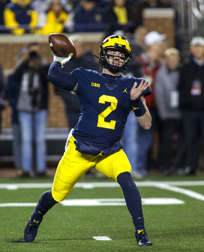 Michigan quarterback Shea Patterson (2) throws a pass during the second quarter of an NCAA college football game against Wisconsin in Ann Arbor, Mich., Saturday, Oct. 13, 2018. (AP Photo/Tony Ding)