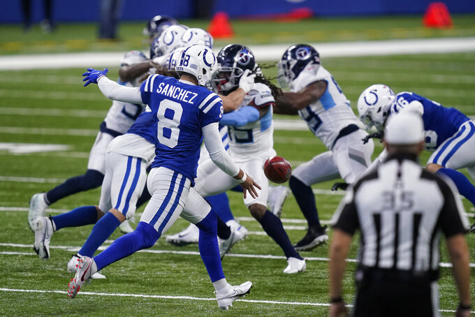 Indianapolis Colts punter Rigoberto Sanchez punts during the second half of an NFL football game against the Tennessee Titans, Sunday, Nov. 29, 2020, in Indianapolis. Sanchez says he will have surgery Tuesday, Dec. 1, 2020, to remove a cancerous tumor. He made the announcement in an Instagram post (AP Photo/Darron Cummings)