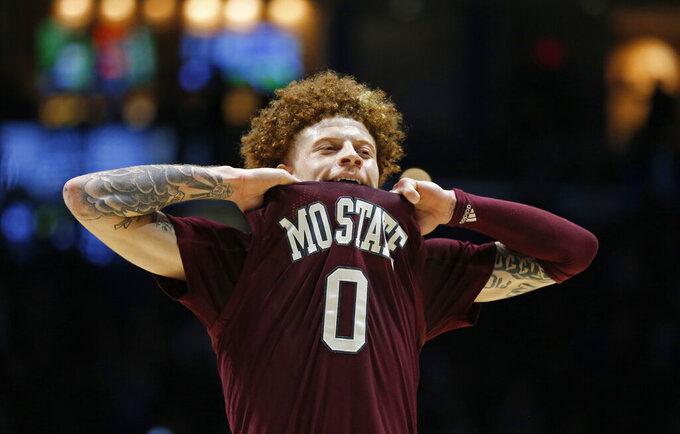 Missouri State guard Tyrik Dixon (0) reacts to a loss to Xavier in an NCAA college basketball game, Friday, Nov. 15, 2019, in Cincinnati. (AP Photo/Gary Landers)