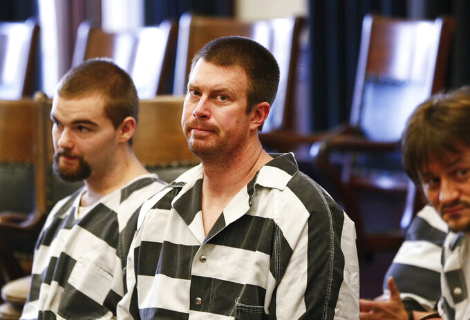 FILE - In this May 8, 2012, file photo, Ryan Leaf, center, sits in a Cascade County courtroom in Great Falls, Mont. Ryan Leaf spent most of his time in prison alone and angry until a military veteran persuaded the former No. 2 overall NFL draft pick to stop self-loathing long enough to help fellow inmates learn to read. Now the once-star quarterback who is widely considered the biggest bust in league history is helping former players adapt to retirement and trying to make sure they cope far better than he did. (Larry Beckner/The Great Falls Tribune via AP, File)