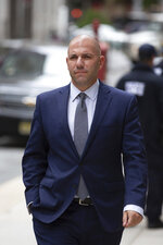 David Correia arrives at federal court, Thursday, Oct. 17, 2019, in New York. Correia and Andrey Kukushkin were set to be arraigned Thursday on charges they conspired with associates of Rudy Giuliani to make illegal campaign contributions. (AP Photo/Kevin Hagen)
