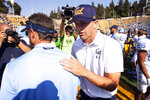 California head coach Justin Wilcox, right, greets North Carolina head coach Larry Fedora following California's 24-17 victory in an NCAA college football game, Saturday, Sept. 1, 2018, in Berkeley, Calif. (AP Photo/D. Ross Cameron)