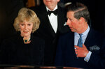 FILE - In this Thursday, Jan. 28, 1999 file photo, Britain's Prince Charles and his companion Camilla Parker Bowles leave the Ritz Hotel in London, the first time that the couple, who have been friends for more than 25 years, have appeared together in public. Divorce has bedeviled the royal family, creating problems not only when senior figures like Prince Charles and Princes Diana ended their marriage in most bitter fashion but also when royals fell in love with people who had been divorced. By the time Prince Charles married Camilla Parker-Bowles in 2005, the social climate had changed to the point that the divorced heir to the throne could marry a divorced woman who had long been his lover. (AP Photo/Alastair Grant, File)