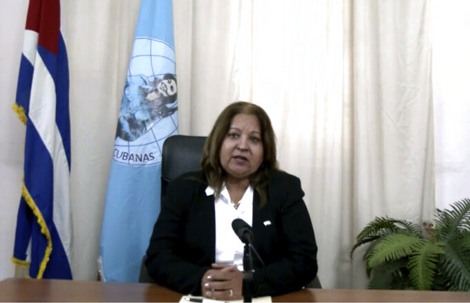 In this image made from UNTV video, Teresa Amarelle Boue, Member of the Council of State of Cuba, speaks during a pre-recorded message which was played inside the United Nations General Assembly Hall, Thursday, Oct. 1, 2020, at U.N. headquarters, in New York. (UNTV Via AP)